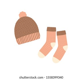 Knitted hat and socks flat vector illustration. Warm clothing, winter knitwear. Handmade headwear and footwear isolated on white background. Garments shop products, cold weather protection accessories
