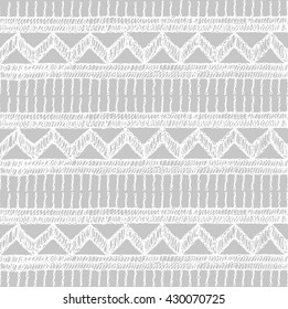 Knitted lace, lace pattern crochet, macrame. Floral seamless pattern with a fringe border knitted or woven macrame in boho style, chevron