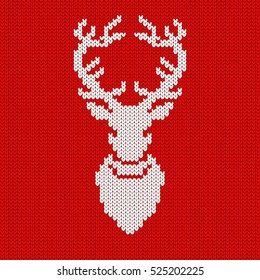 Knitted red Christmas background with reindeer Rudolph. Seamless pattern