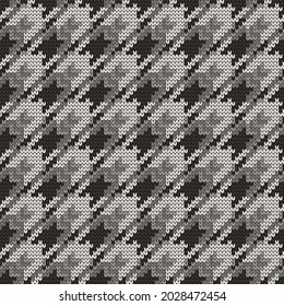 Knitted seamless goose foot black white pattern. Vector illustration.