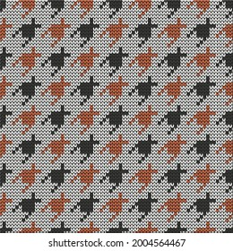Knitted seamless goose foot pattern. Modern fabric design. Vector illustration.