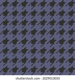 Knitted seamless goosefoot pattern. Goose foot design on blue background. Vector illustration.