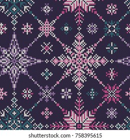 Knitted seamless multi-colored pattern of snowflakes.Vector