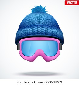 Knitted woolen blue cap with snow ski goggles. Winter seasonal sport hat. Vector illustration isolated on white background.