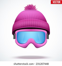 Knitted woolen cap with snow goggles. Winter seasonal sport hat. Vector illustration isolated on white background.