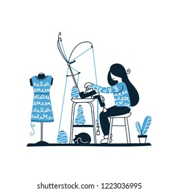 Knitter is using knitting machine. Woman creates knitted fabric at home. Girl performs an order for a knitted dress