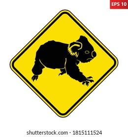 Koala road sign. Vector illustration of yellow diamond shaped traffic sign with koala icon inside. Koalas crossing warning symbol isolated on white background. Australian animal sign.