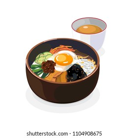 Korean food , Bibimbap in a bowl serve with hot tea