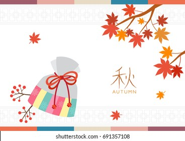 Korean traditional lucky bag with maple leaves background.Translation: Autumn