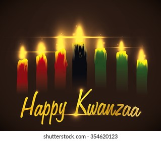 Kwanzaa candles lighted with golden greeting message.