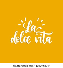La Dolce Vita translated from Italian The Sweet Life, handwritten phrase. Vector calligraphy of inspirational quote on yellow background.