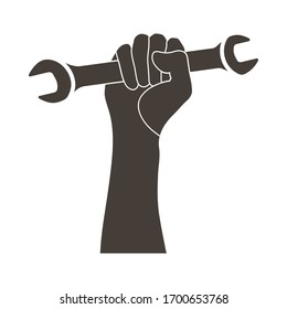 Labour day emblem with wrench in fist. Vector illustration.