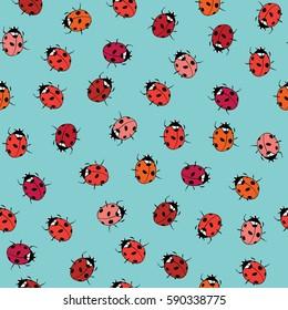 Ladybugs seamless pattern. Vector illustration on blue background
