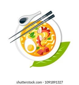 Laksa soup with noodles shrimps fish egg chopsticks spoon bamboo leaf traditional asian cuisine food dish