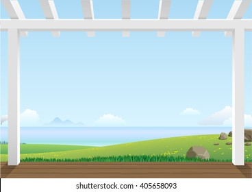 Landscape with green hills and the sea in the distance on a clear day from the pergola on the terrace