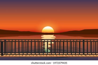 landscape of wooden bridge on the beach in sunset