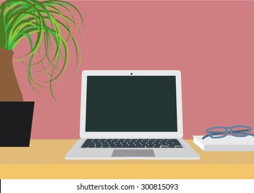 Lap top with plant