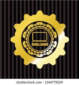 laptop icon inside golden emblem or badge