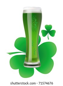 a large glass of green beer with clover leaf on white background
