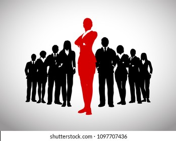 A large team of successful executives in silhouettes led by a great remarkable Female leader in red who stands in front of them.