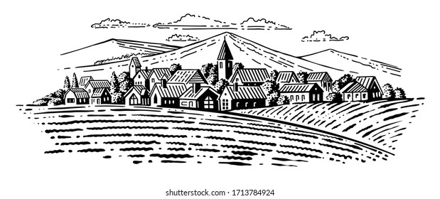 large village with fields on mountains background