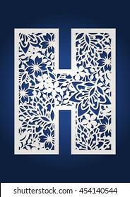 Laser cut monogram initial letter H with floral pattern.