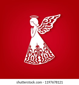 Laser cut paper Christmas angel on a red background. Greeting Card for wood carving, paper cutting and Easter decorations. Beautiful applique on red background. Abstract Isolated vector objects.