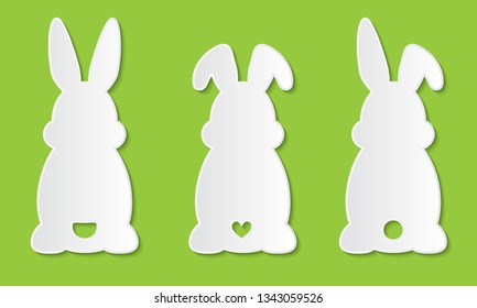 Laser cut template. Set of clipart Easter rabbits with ears and tail. For Happy Easter hunt. Vector silhouette of back of fun bunny. Sample illustration isolated on green background. Die cut paper.