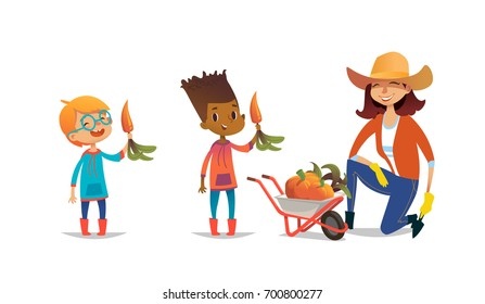 Laughing multiracial children holding carrots and female agricultural worker dressed in rubber boots and straw hat standing on one knee beside wheelbarrow full of pumpkins. Vector illustration.