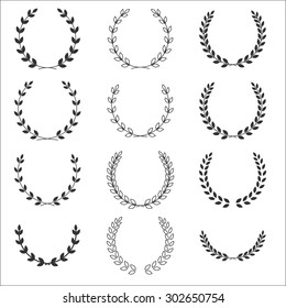 Laurel wreathes set - symbol of victory and achievement. Design element for construction of medals, awards, coat of arms or anniversary logo. Gray icons silhouette on white background
