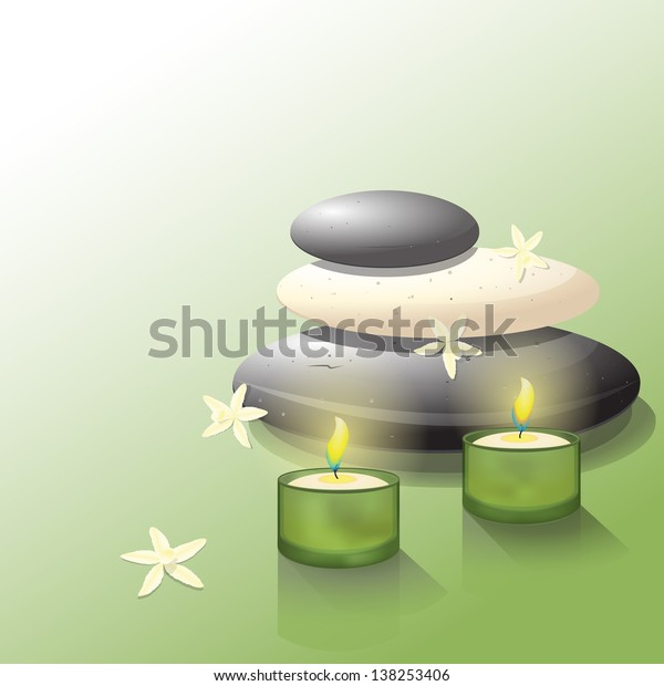 Lava rocks with two candles and vanilla flowers