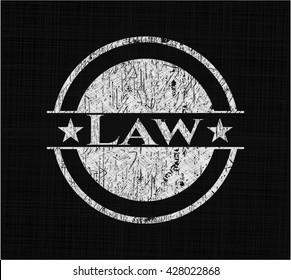 Law chalkboard emblem on black board