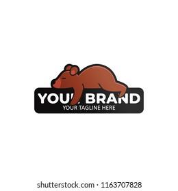 Lazy bear logo icon badge. Bear sleeping on a stone illustration