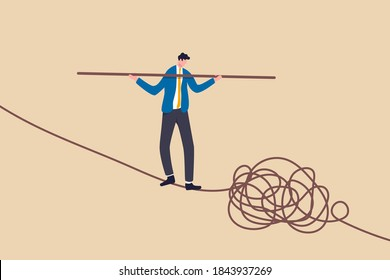 Leadership skill to lead company in crisis situation, manage to solve risky problem concept, confidence businessman leader acrobat walk balance on danger high rope and try to solve tightrope problem.