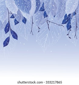 Leaves covered with frost, blue colors, frozen tree branches, snowing. Beautiful winter background for your design.