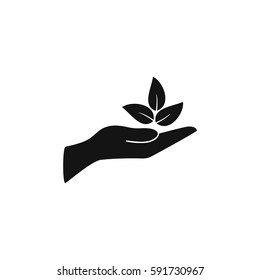 Leaves in a hand sign of environmental protection icon. Eco sign. vector illustration.