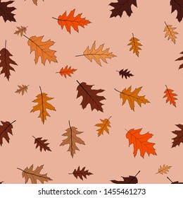 The leaves of red oak, bronze shades on a beige background. Seamless pattern