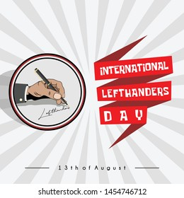 """left hand writing """"international lefthanders day"""" with a ballpoint, which is celebrated on August 13"""