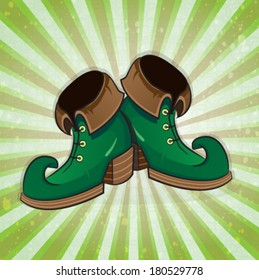 Leprechaun shoes on a striped background. St. Patrick's Day symbol