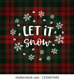 Let it snow Christmas greeting card, invitation with circle of falling snowflakes. Hand lettered white text over tartan checkered plaid. Winter vector calligraphy illustration background.