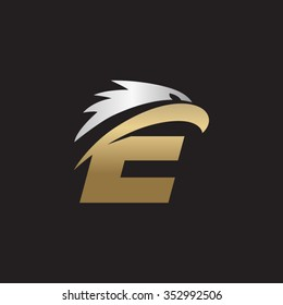 letter E eagle head silver gold logo black background