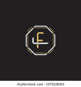 Letter initial FL F L LF monogram logo classic style with emblem hexagon line isolated on black background and gold silver colors combination