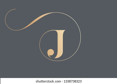 Letter J logo.Typographic icon in golden color isolated on dark background.Serif uppercase lettering.Initial character with round frame and swirl.Luxury style sign.