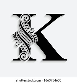 letter K. Black flower alphabet.  Beautiful capital letter with shadow