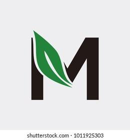 Letter M logo with leaf element, Arbor Day. Ecology concept.