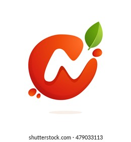 Letter N logo in fresh juice splash with green leaves. Vector elements for natural application, ecology presentation, business card or cafe posters.