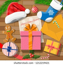 Letter from santa claus. Wooden desk gift boxes, candycane, envelope, holly, sock, hat, gingerbread man, ball fur branches. Wishes presents christmas xmas new year eve. Vector illustration flat style