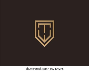 Letter T and W in shield logo design template. Premium monogram business sign. Universal vector icon