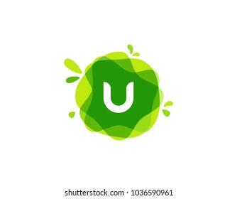 Letter U logo at green watercolor splash background. green nature logo vector