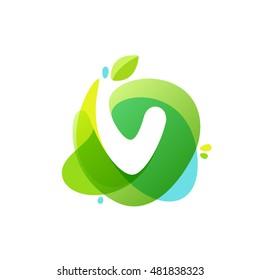 Letter V logo at green watercolor splash background. Vector elements for posters, t-shirts, ecology presentation or card.